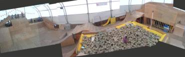 Panorama of the Whistler AirDome - showing the 30ft roll-in on the left, foam pit in the centre, various step-up jumps, and vert walls on right.