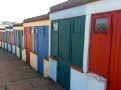 Multicoloured beach huts at the surf beach...