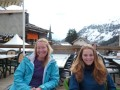 CJ and Pips having apres ski drink at Le Tours overlooking the valley