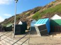 Beach huts blown over by the gales, Southbourne