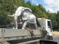 Well, you don't see a silver elephant on the back of a lorry every day...