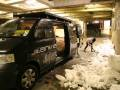 Sonia digging snow into the Animal van - it took 7 hours to build the wallride (copyright Mark Haysom 2010)