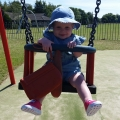 Violet loves swings!