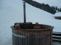 The homemade barrel-construction hottub - note the submerged stove with chimney